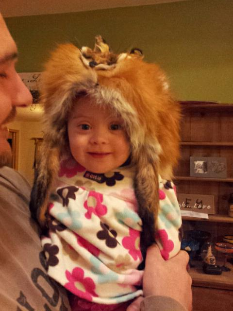 Wearing dad's fox hat!