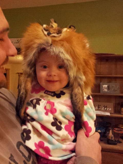 Wearing dad's fox hat!